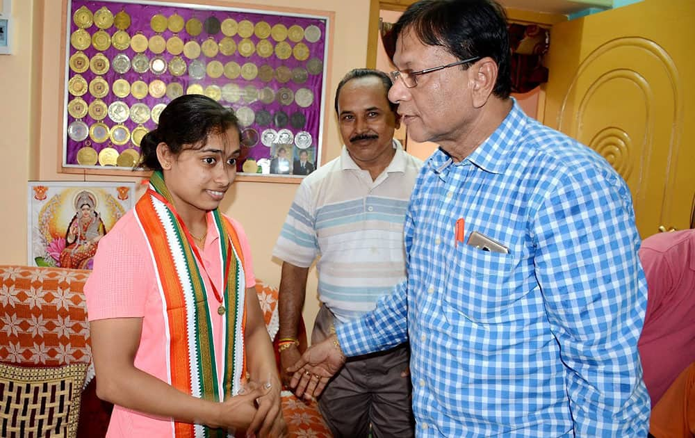 Kolkata East Bengal Football Club ex- president gifts a diamond jewellery medal to gymnast Dipa Karmakar