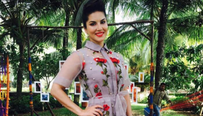 Looks like it takes a lot of men to doll up Sunny Leone- See pic