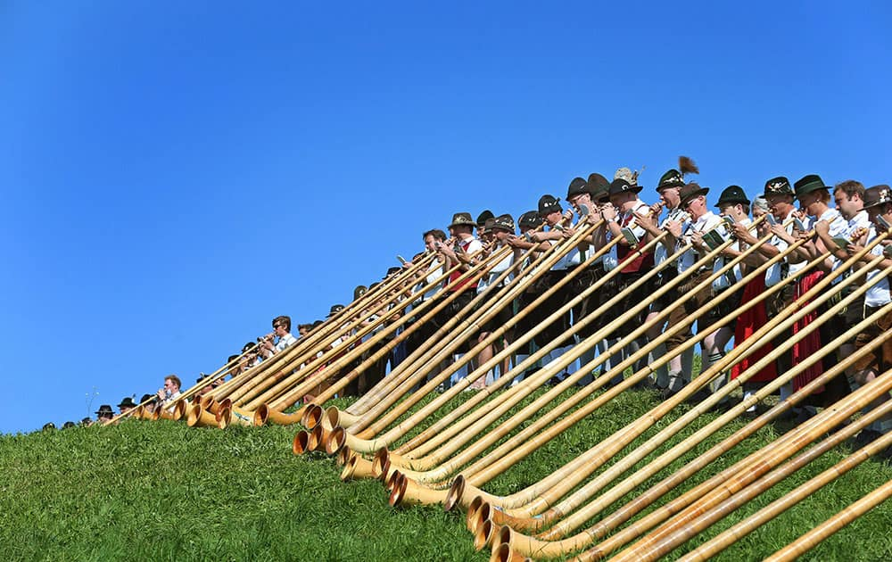 Alphorn musicians perform in Nesselwang, southern Germany