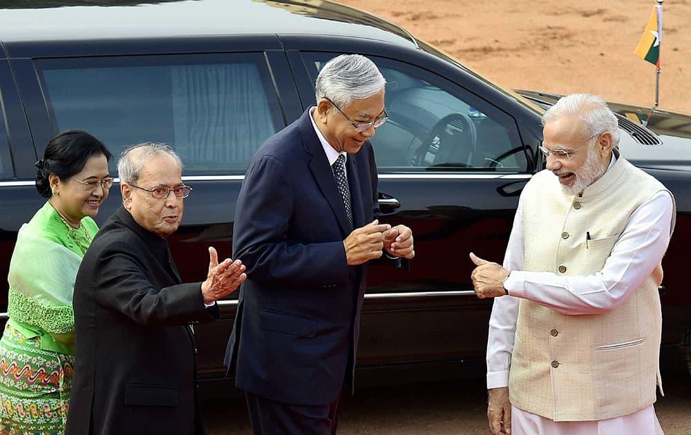 Prime Minister Narendra Modi gestures to Myanmar President U Htin Kyaw
