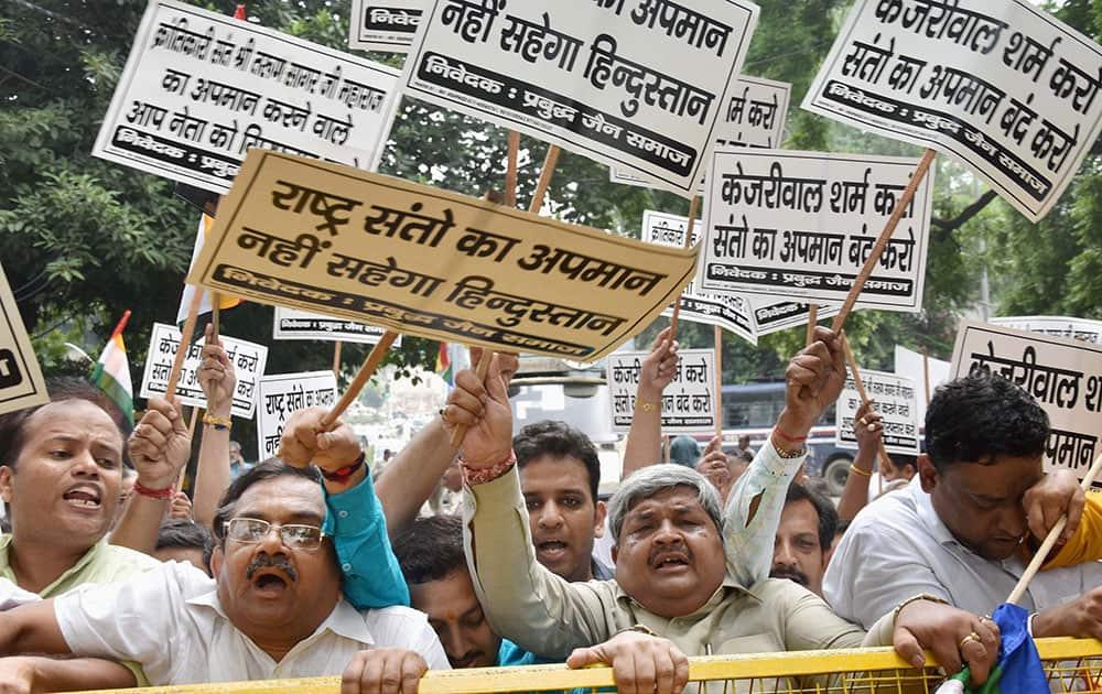 Members of Jain Samaj shout slogans and hold placards to protest against Vishal Dadlani