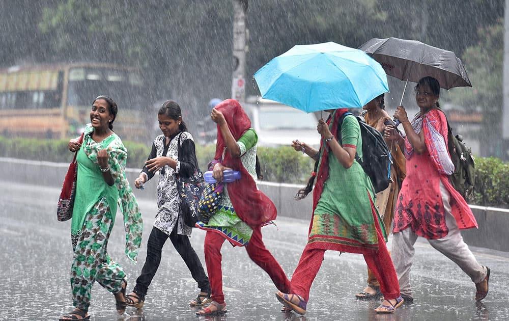 College girls walking in rain in Chennai
