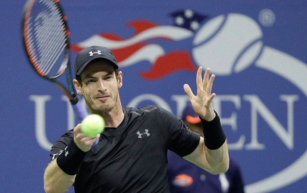 Andy Murray, of Britain, returns a shot to Lukas Rosol, of the Czech Republic, during the first round of the U.S. Open tennis tournament in New York