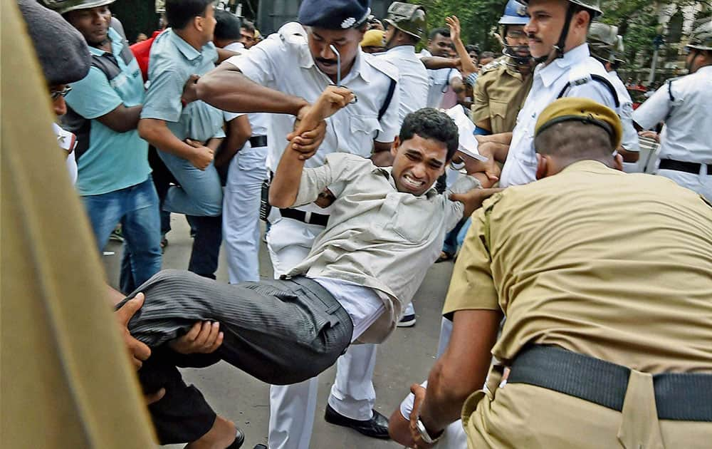 Police detain a SUCI activists during their agitation to protest against gangrape and murder of a 12 years old pavement girl