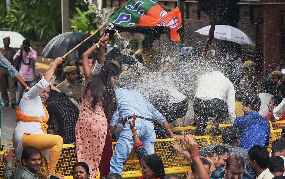 Police use water cannons to disperse Delhi BJP members during a protest