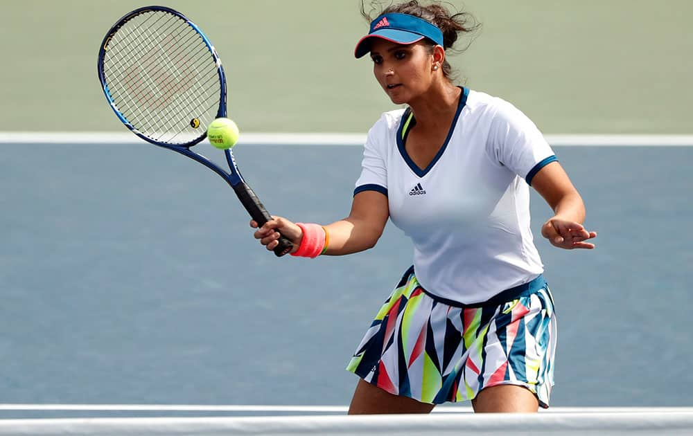 Sania Mirza returns a shot during a womens doubles match in the third round of the US Open tennis tournament in New York