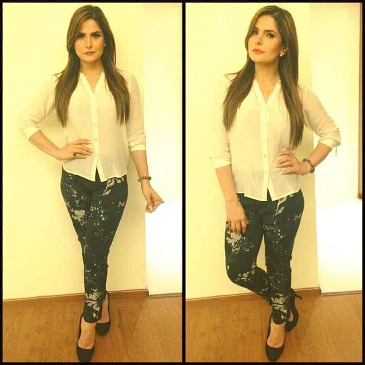 zareen khan :- Wearing a white crape shirt with appliquéd cigarette pants embellished with swarovski crystals from Designer Nikita Mhaisalkar @nikita_mhaisalkar for the APPLE store launch in Rudrapur