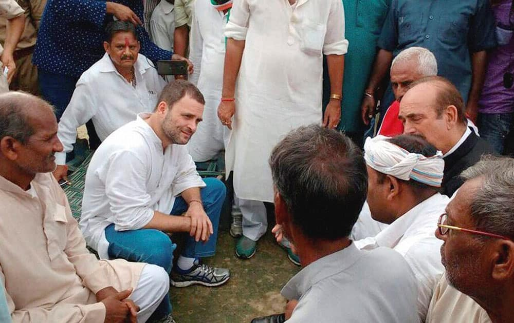 Congress Vice President Rahul Gandhi meeting with farmers at Khat pe Charcha programme during his Kisan Yatra in Deoria