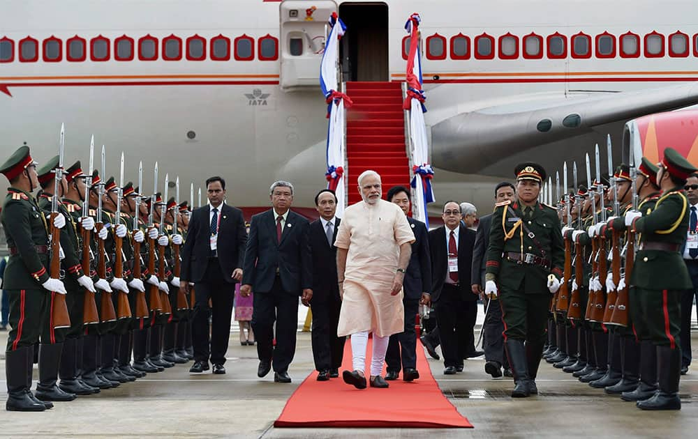 Prime Minister Narendra Modi is welcomed upon his arrival at Vientiane International airport in Laos