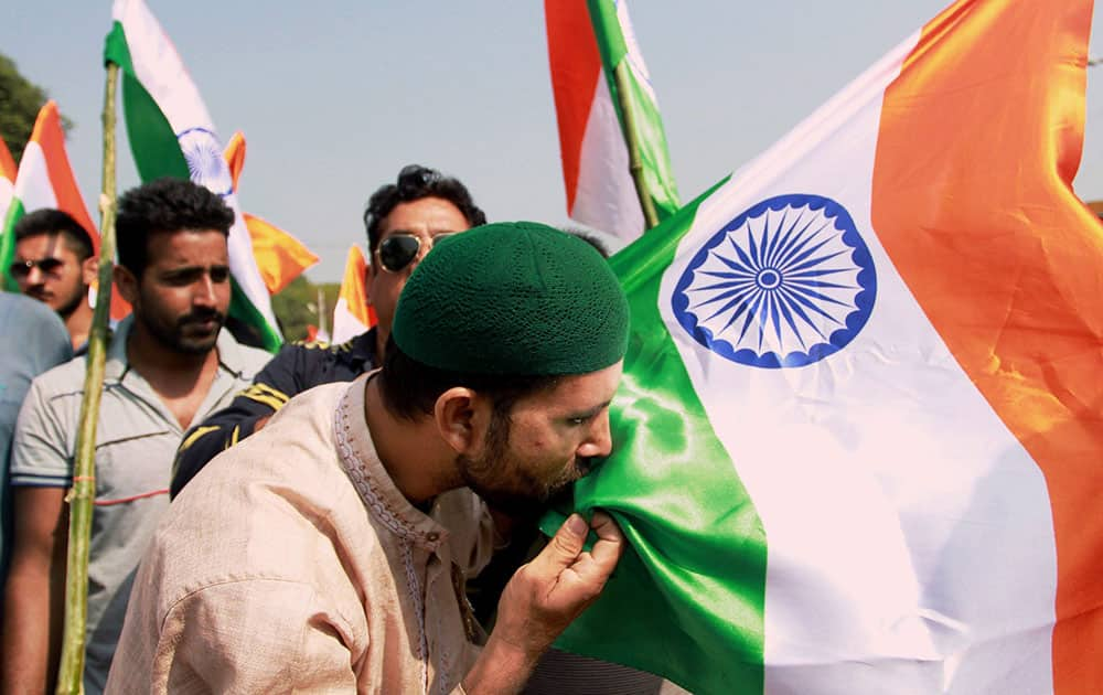 A member of the Jammu Citizens Forum kisses the Tricolour during the Tiranga Yatra in support of the Indian Army and security forces, in Jammu