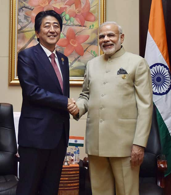 Prime Minister Narendra Modi with his Japanese counterpart Shinzo Abe during a bilateral meeting at 28th and 29th ASEAN Summit in Vientiane, Laos