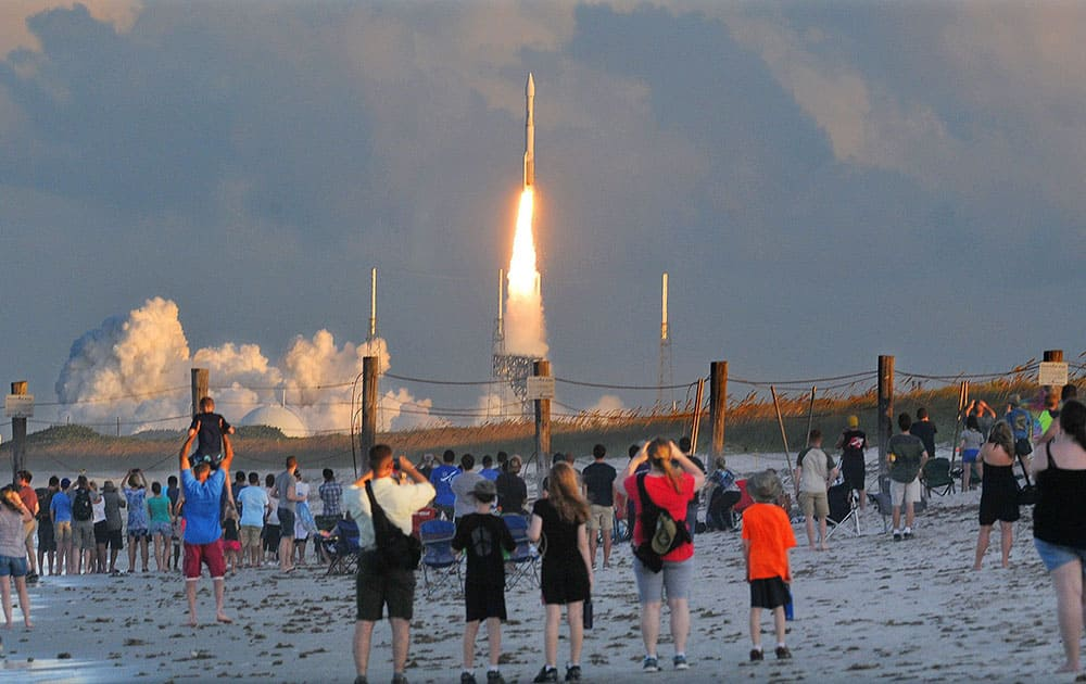 Hundreds of people pack the Canaveral National Seashore to witness the launch of a United Launch Alliance Atlas V rocket in TITUSVILLE