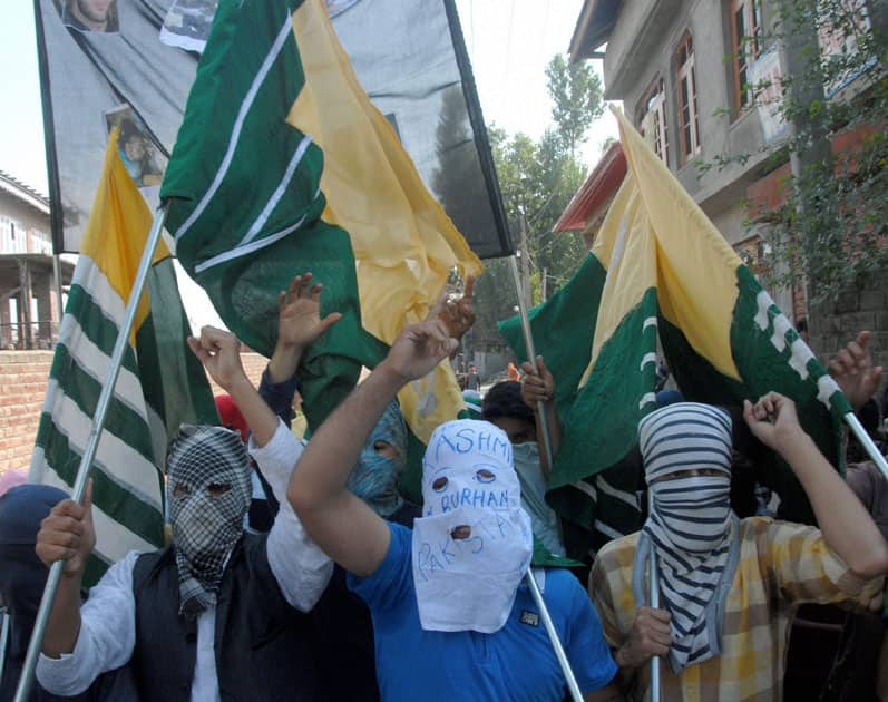 Masked youth carrying flags and shouts sloags