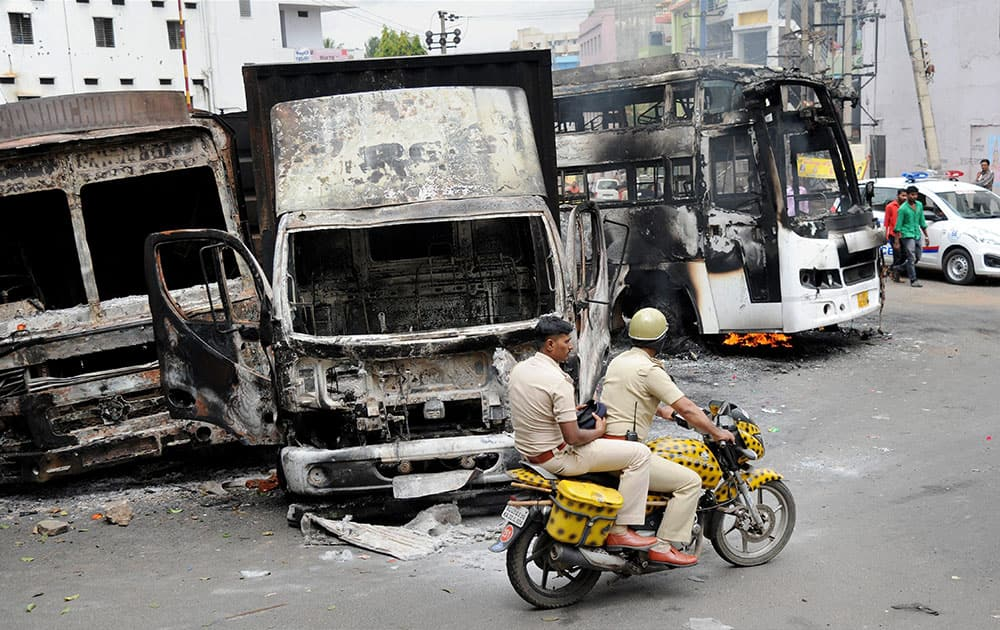 Charred remains of the vehicles in Bengaluru