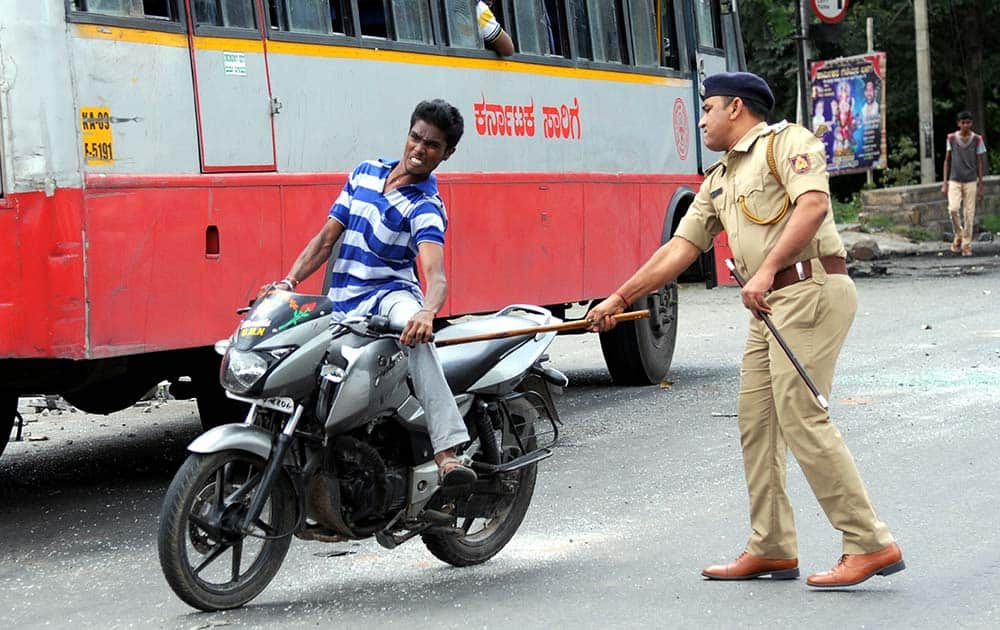 A police man charges a miscreant riding motorcycle