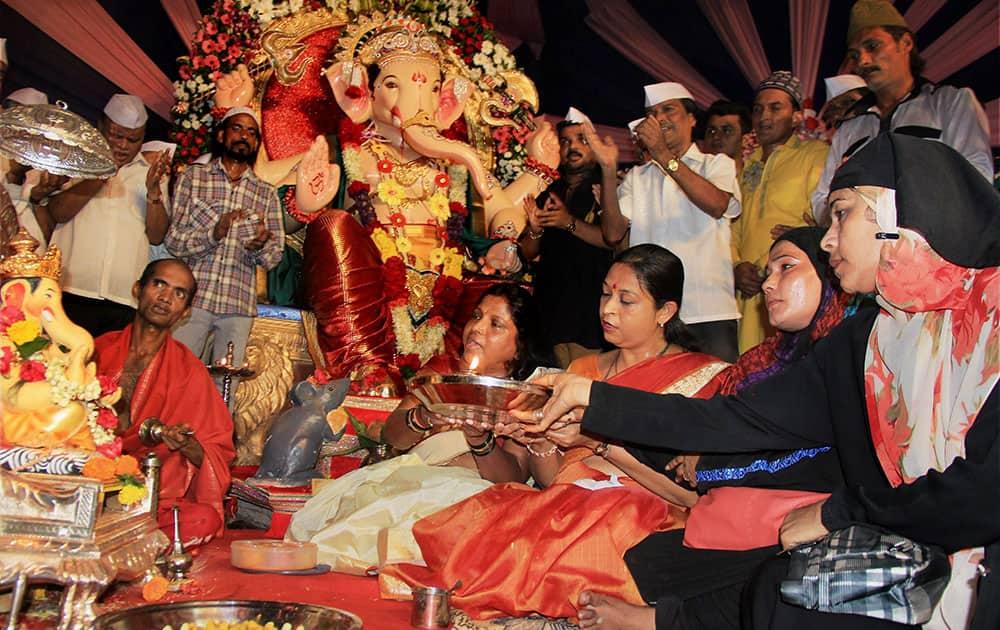 Muslim women perform aarti at a Ganesh Pandal during Ganeshotsav in Mumbai