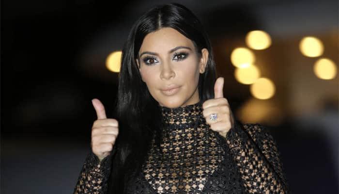 Kim Kardashian Covers Herself in Just Glitter in Latest