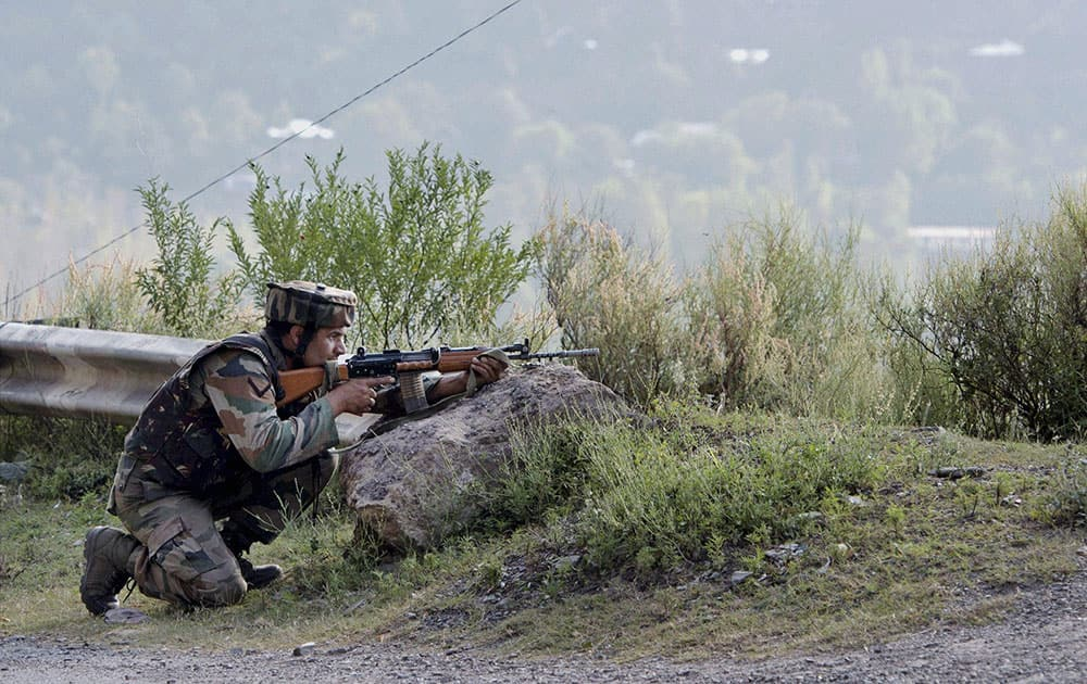 An Army soldier takes position near Army Brigade camp during a terror attack in Uri, Jammu and Kashmir