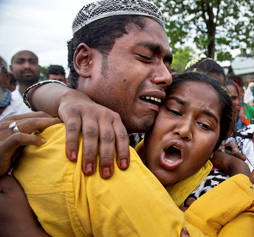 Relatives mourn during the funeral procession of Anjuma Beghum who was killed in clashes with the police during an eviction drive at Kuthori village on the periphery of the Kaziranga National Park