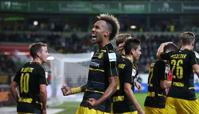 Borussia Dortmund beat Freiburg 3-1 to join Bayern Munich at the top of Bundesliga table