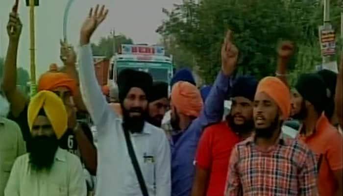Tension grips Jalandhar as torn pages of Guru Granth Sahib, Bhagavad Gita found in canal