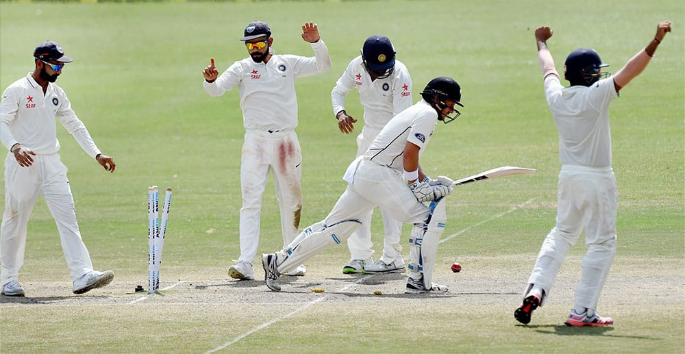 Indian team celebrates victory over New Zealand during the 5th Day of first test match at Green Park in Kanpur