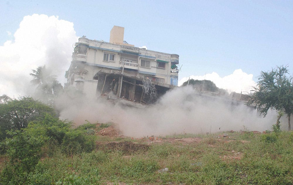 An illegally constructed double-storeyed building is blasted