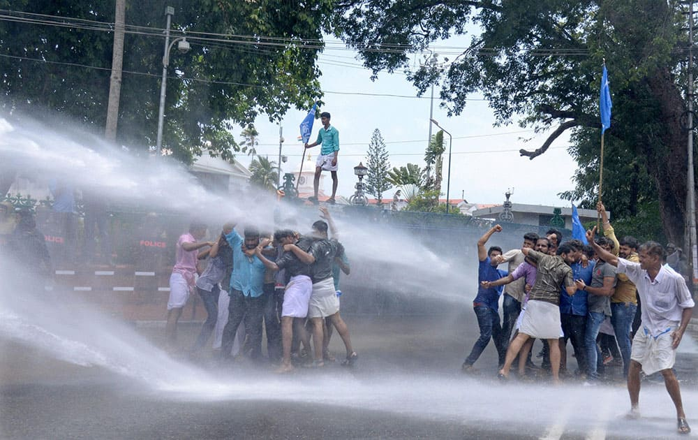 Police use water cannons to disperse Kerala Students' Union (KSU) activists during a protest