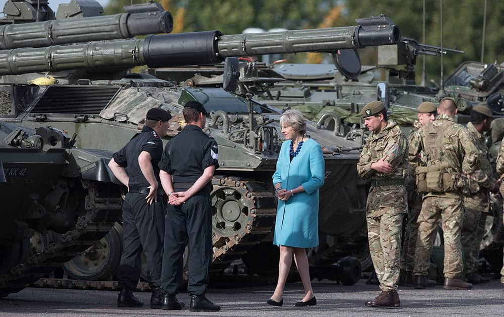 Britains Prime Minister, Theresa May, centre, greets troops as she visits 1st Battalion The Mercian Regiment at their barracks at Bulford Camp near Salisbury
