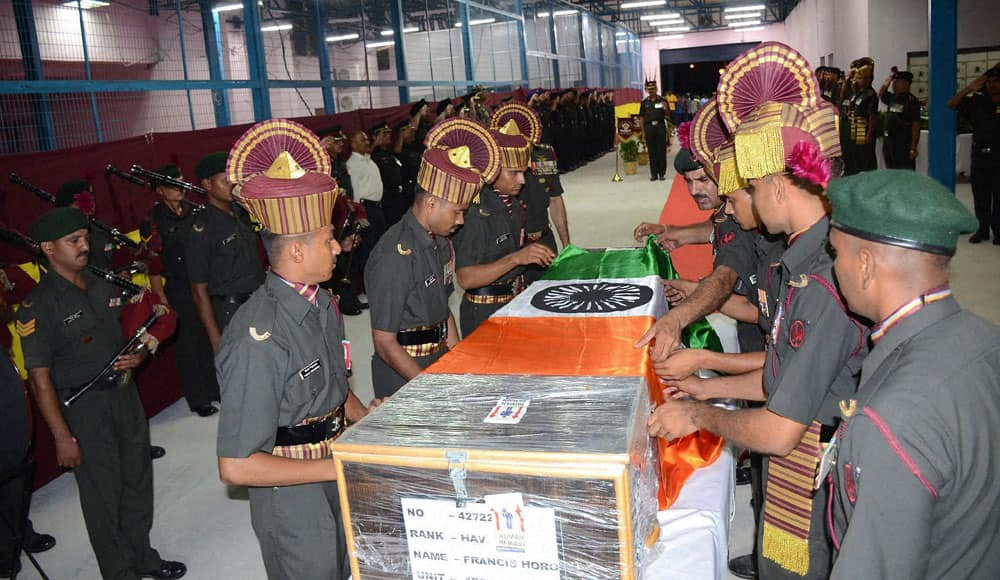 Army personnel with coffin of Martyred Francis