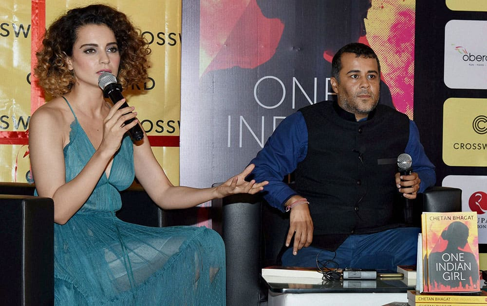 Bollywood actor Kangana Ranaut with author Chetan Bhagat during launch of the book One Indian Girl in Mumbai