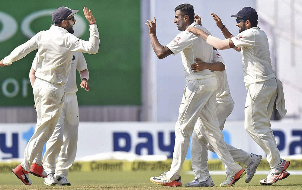Indian players celebrate the fall of a wicket on the fourth day of the second Test match against New Zealand at Eden Garden in Kolkata