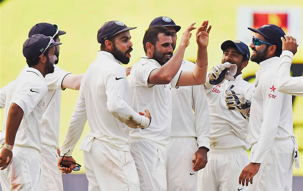 Indian players celebrate the wicket of BJ Watling on the fourth day of the second Test match against New Zealand at Eden Gardens in Kolkata