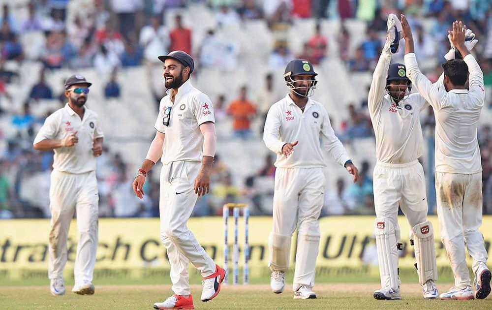 Skipper Virat Kohli with teammates celebrates after Team India won the 2nd Test match against New Zealand, at Eden Garden in Kolkata