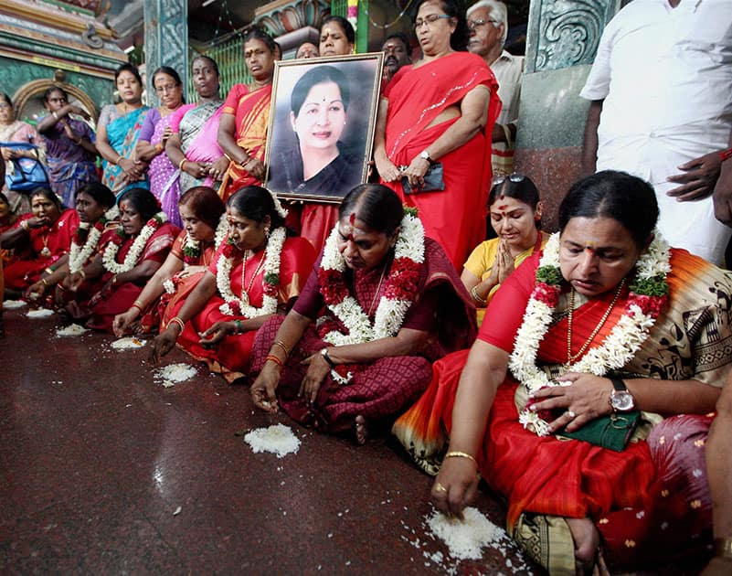 AIADMK women wing members having food from the floor as a prayer for a speedy recovery of party supremo and Chief Minister J. Jayalalithaa