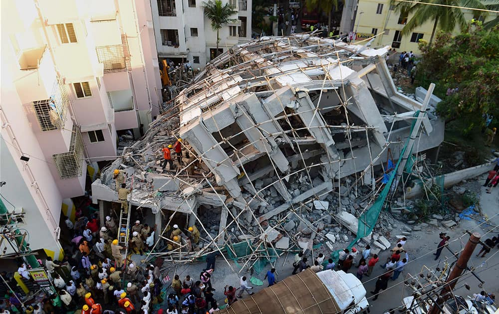 NDRF personnel carry out the rescue work after an under construction building collapsed at Belandur in Bengaluru