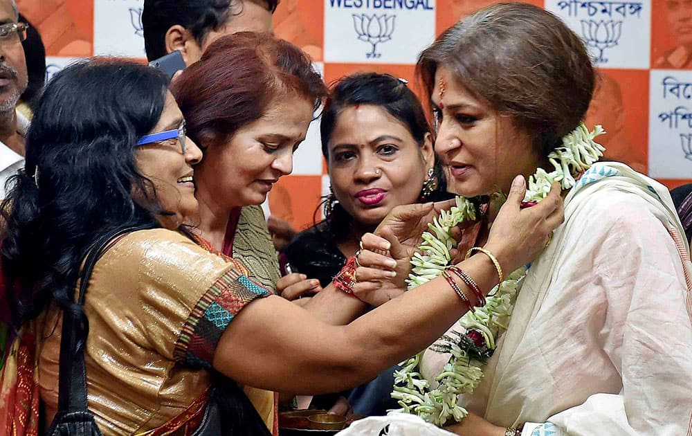 Actress and BJP leader Rupa Ganguly celebrates her victory in the Rajya Sabha eelection, at State Party office in Kolkata