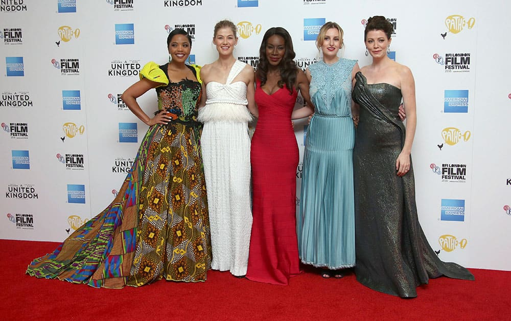 Actresses Terry Pheto, from left, Rosamund Pike, director Amma Asante, actresses Laura Carmichael and Jessica Oyelowo pose for photographers upon arrival at the premiere of the film A United Kingdom, which opens the London Film Festival