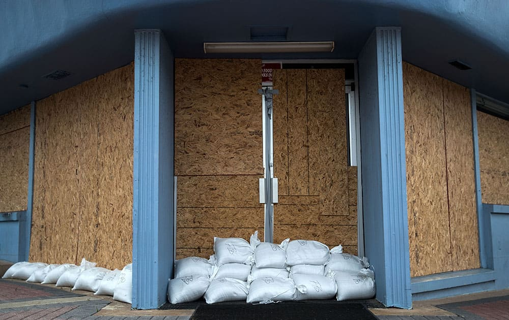 A storefront is barricaded with sandbags in Daytona Beach