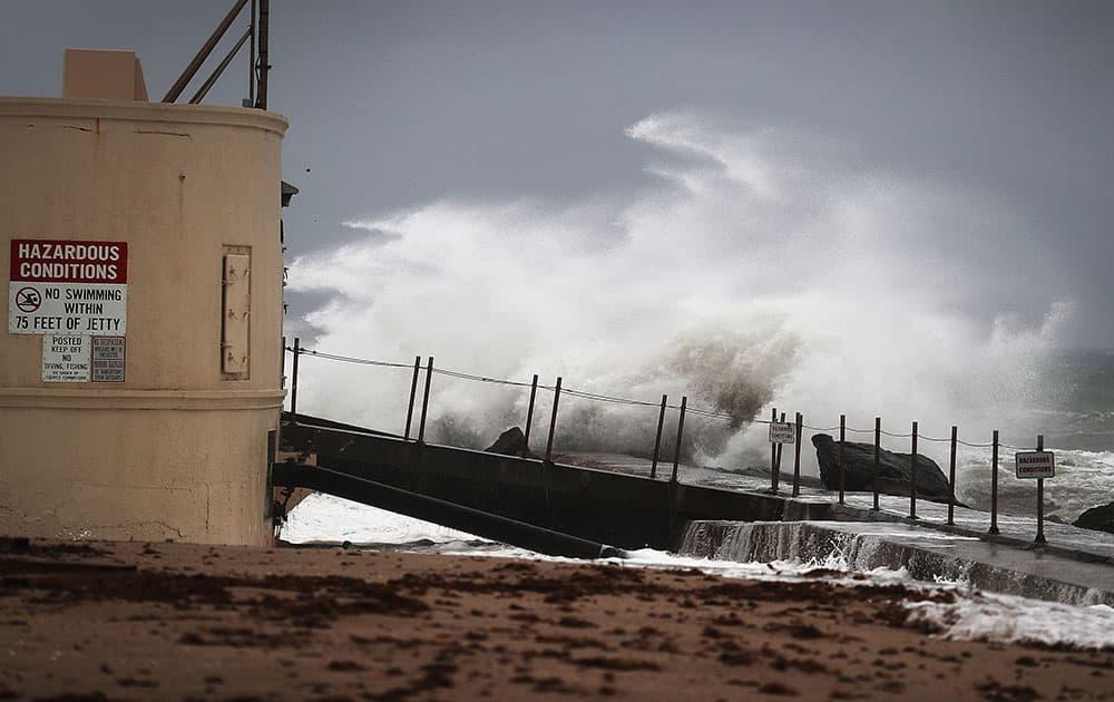 Waves crash ashore as Hurricane Matthew approaches the area in Singer Island, Florida
