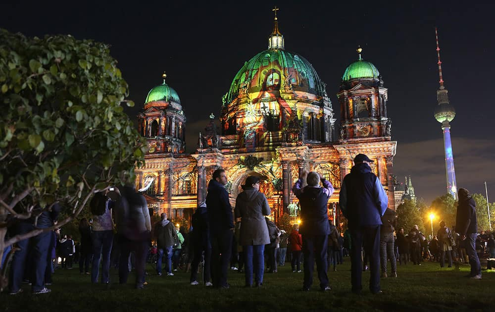 The Berliner Dom (cathedral) is illuminated with projections in Berlin, Germany