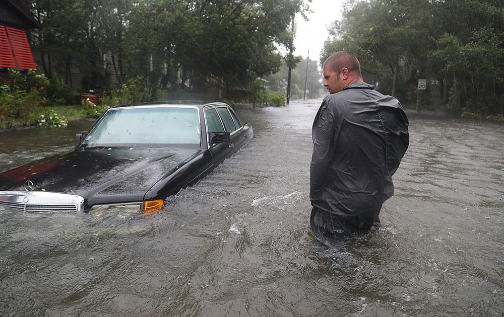 Nick Lomasney walks through heavy wind and a flooded street as Hurricane Matthew passes through the area in St Augustine, Florida