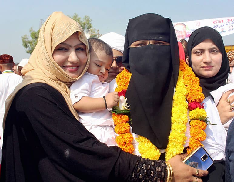 A Haj pilgrim being welcomed by her relatives upon her arrival from Mecca, at Raja Bhoj Airport in Bhopal
