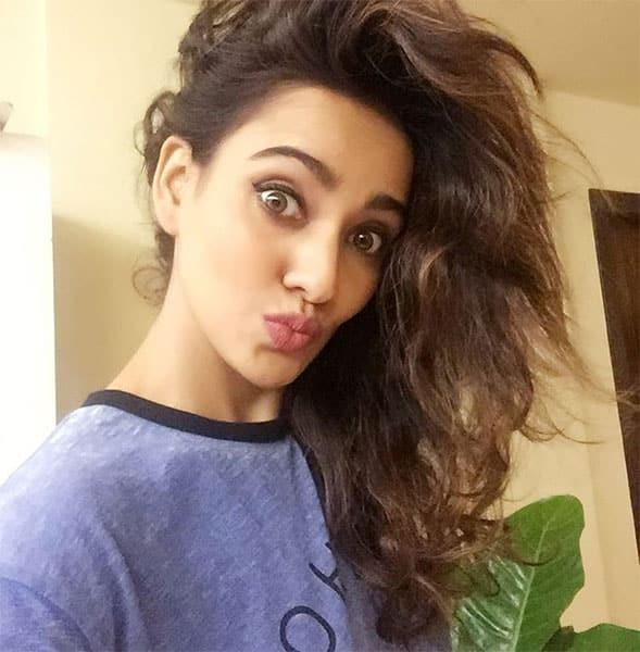 neha sharma :- Got home after a crazy day to crazy hair zzzzz....good night lovelies