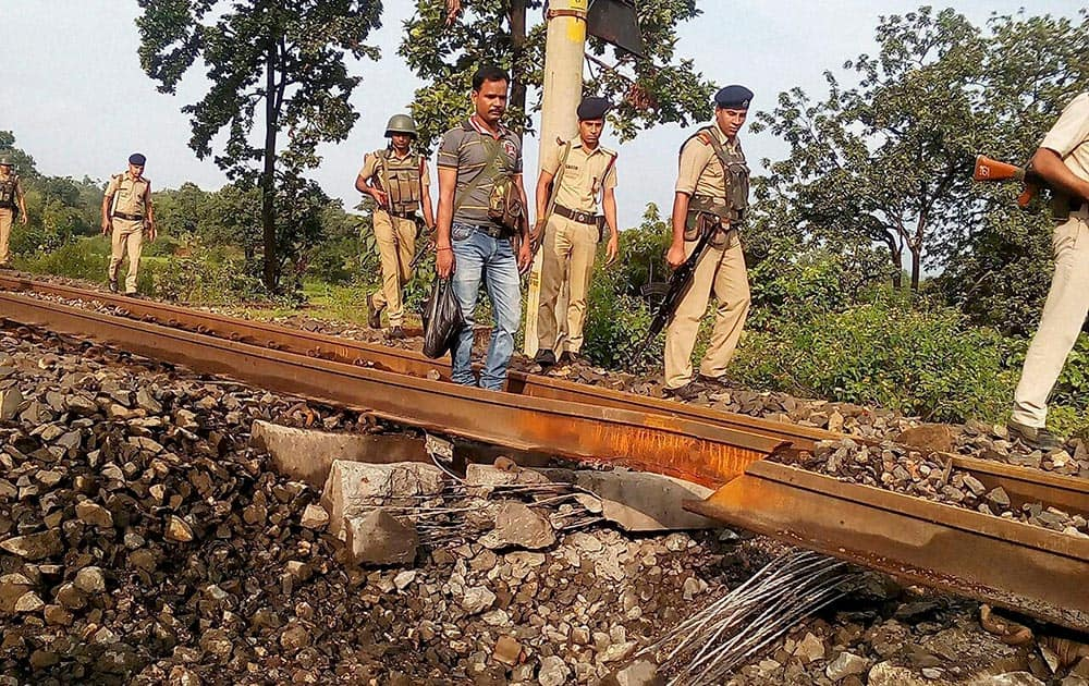 Police personnel investigate after Naxals blasted