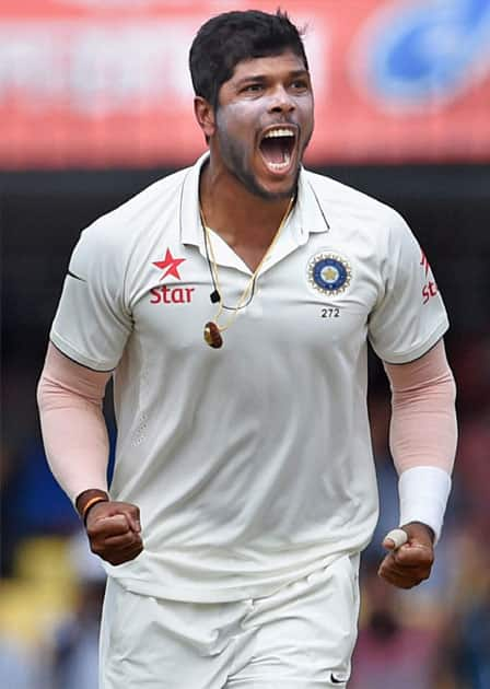 Umesh Yadav celebrates the wicket