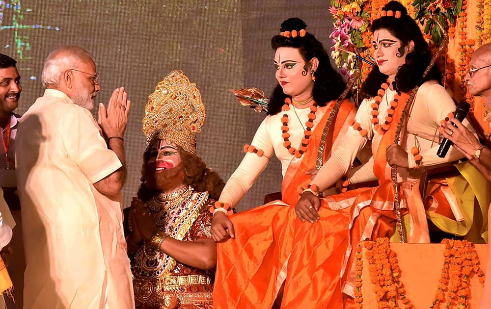 Prime Minister Narendra Modi with artists enacting Lord Rama and Lakshman during Dussehra celebrations at Aishbagh Ram Leela in Lucknow