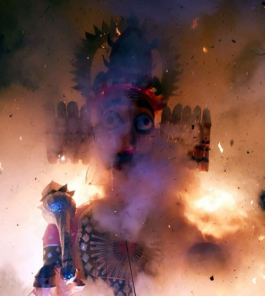 An effigy of demon king Ravana being set on fire during the Dusshera celebrations of Shri Dharmic Leela Committee at Red Fort ground