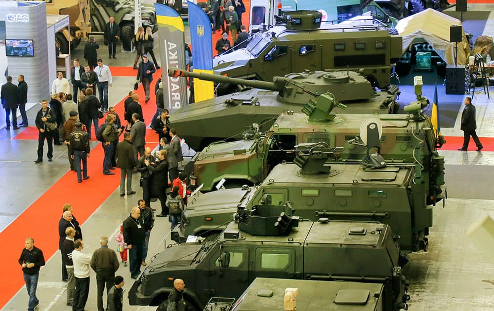 People attend an armament exhibition of Ukrainian made weapons in Kiev