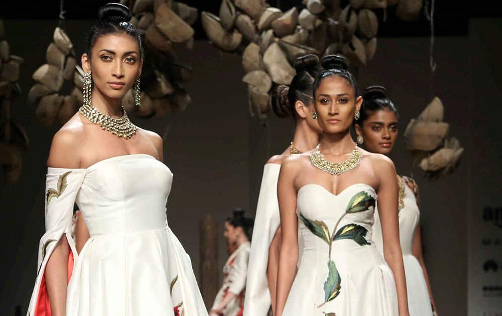 Models walk on ramp for the designer Samant Chauhan during the inaugural show of Amazon India fashion week in New Delhi